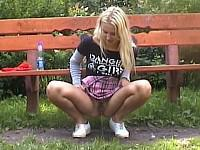 Blonde pees outdoors