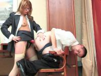 Strap-on armed secretary probing and poking guy's ass right on the table