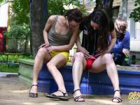 Outdoor shorts wetting by two sexy girls