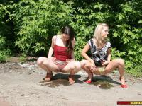 A brune gal and a blondie wet panties