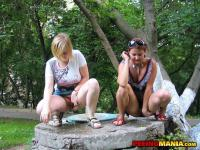 Gals pull knicks aside to pee on a stone