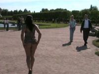 Sweet teen plays with her massive boobs in public