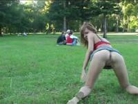 Teen slut spreads her firm buns in a public place