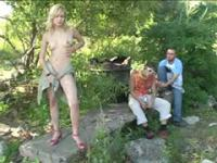 Horny ho gets nude in front of two passers-by