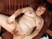 Chubby redhead lets her fingers do the walking