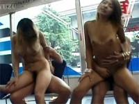 Two horny asian chicks banged in front of a public window