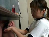 Sexy asian school chick giving two guys a horny handjob