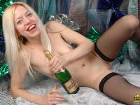 Teenage blonde camgirl playing with her big champagne bottle