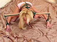 Topless blonde in green body harness posing and enjoying her first ever bondage orgasm