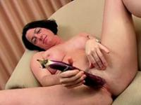 Busty milf fucks all kinds of veggies