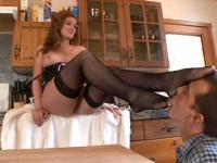 Pretty milf in fishnet stockings allows dude to suck her toes then gives him a great footjob