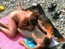 A horny couple having fun in water and at the seaside