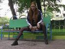 Impudent babe pees sitting on the bench