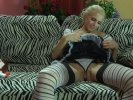 Lewd maid in striped stockings going for pussy-fingering after a working day