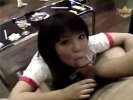 A young Asian girl is walking through a hall full of men, some of which are half naked. She kneels down in front of one of thm and washes his dick. Then she gives him a long blow job and lets him come in her mouth.