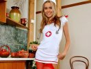 Smiling blonde nurse Katty posing in red crotchless pantyhose