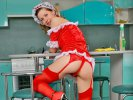 Brunette maid Annabel shows her red outfit and stockings during doing the room