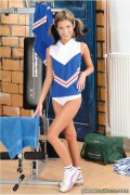 Cheerleader strips at gym. Delightful cheerleader stripping at gym