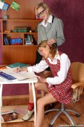 Schoolgirl and teacher. Teacher works with naughty schoolgirl