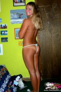 Young blonde girl asked her boyfriend to make hot pictures of her. Topless chick wore nothing but tiny bikini panty exposing well-shaped body