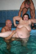 2 dads playing with a fat old bitch in the pool