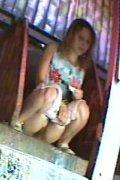 Blonde chick emptying her bladder in park toilet