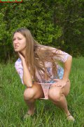 Spying on nice shaved teen peeing in the park