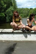 Three teen whores pissing off the old bridge
