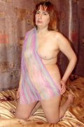 Beautiful chubby mature stripping in lingerie