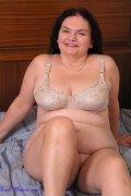 Mature plumper in beige lingerie