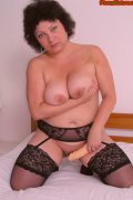 Mature chubby brunette ready for dildo insertion