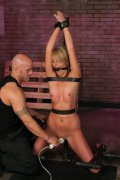 This giggly little slave named Amy has found herself at the mercy of her master but, she is so nervous that she giggles as soon as the pain comes. Derrick is known for breaking little slaves like this and today was no exception. He starts her where every whore belongs, on her knees. She gets her first taste of how aggressive he his with flogging and overall impact on her delicate body. She waits for him to penetrate her in hopes that the pain will stop, but, he doesn't. Next, she is locked into a bent position by steel and wood to insure she takes everything he gives her. He punishes her pussy and mouth with his cock until she is exhausted but, she's not even close to satisfying him. He continues the punishment until he feels like she deserves his cum unloaded on her body.