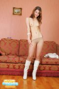 Willowy girl wearing only tights and high boots
