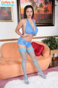 Busty brunette babe poses in tight blue stockings