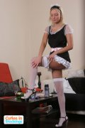 Sexy stockinged maid shows she's got no panties on