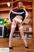 Sexy stockinged maid shows she�s got no panties on