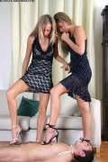 Models in short dresses go wild trampling a guy in their apartment