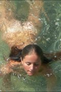 Naked beach girl caught having fun with a horny guy