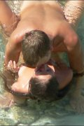 An unsuspecting nude couple doing the do on a beach