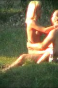 Hot nudist couple make love on a lush meadow