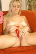 Sassy blonde playfully stripping off her clothes and inserts a red dildo into her wet cunt live