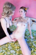 Dolled-up older babe encourages a curious lass into lez sex with hot kisses