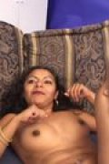 A long haired Hindu girl in interracial action on the couch