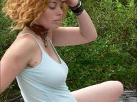 Isobel - Mature Hairy Hippie Goddess with Red hair shows her full bush as she strips.