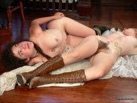 Pandora and Artimus - Two long haired Hippie girls in this odd indoor set. Tattoos and hairy bush/pits.