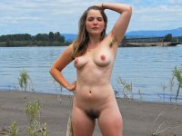 Araya - Beautiful young hippie chick strips at the beach. Hairy bush and armpit hair.