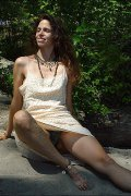 Astarte - Mature,Hairy Hippie goddess shows her furry bush and fuzzy arm pits at the beach.